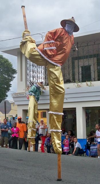 Jumbie on the run! The Guardians of Culture were a parade highlight. (Carol Buchanan photo)