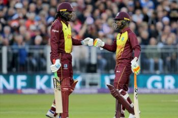 Christopher H. Gayle and Evin Lewis, left, shared in an 88-run opening stand against UAE on March 6, 2018. Photo: Internet Source