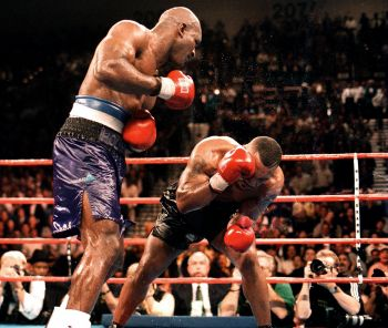 In 1996 Evander Holyfield, left, defeated Michael G. Tyson aka 'Mike', right, to reclaim the WBA title, in what was named by The Ring magazine as the Fight of the Year and Upset of the Year. Photo: The Fight City