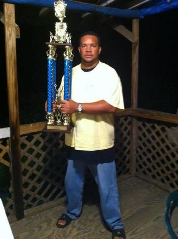 Our Young Professional also loves playing Domino. Photo showing Mr. Campbell with a championship trophy in 2011, he played for team Small Axe. Photo: Provided