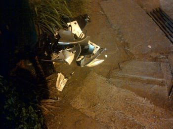 Parts of the motorcycle involved in the accident this evening November 30, 2012 heaped up in the corner at the Wickham's Cay II intersection. Photo:VINO