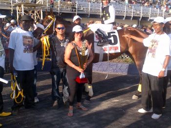 Really Uptown poses with his team following victory in the second leg of the VI Triple Crown Challenge in St Croix (co-owner Violet 'Letty' Hodge poses with trophy in foreground). Photo:VINO team of reporters