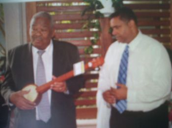 The Hon John P. de Jongh Jr, Governor of USVI gets a gift from Hon Ralph T. O'Neal at Friendship day 2011. Photo: 40th commemorative Booklet.
