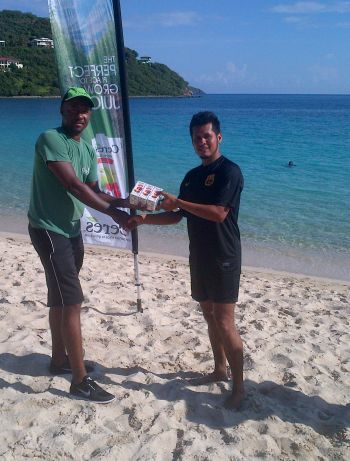 Second place finisher Reuben Stoby (right) receives his spot prize from Representative of Proudly African- the official distributor of Ceres juices in the Virgin Islands, Shaliva Adams. Photo: VINO