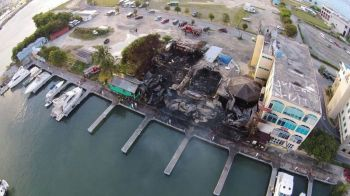 An early morning fire in the vicinity of the Government Complex, across from Banco Popular, in Wickhams Cay, Road Town today April 8, 2014 completely destroyed two businesses and scorched another before it could be contained by firemen. Photo: Bradley Burke
