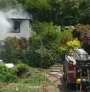Residents blamed the absence of a fire tender assigned for the area for the complete destruction of the Hodge's home today July 2, 2014. Photo: Team of Reporters