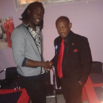 Javon A. Liburd with St Kitts and Nevis Prime Minister Dr Denzil Douglas. Photo: Provided