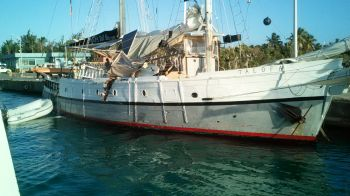 According to our Team of Reporters in Virgin Gorda the barge, which was reportedly transporting materials for road works on Virgin Gorda came into contact with the wooden vessel Talofa causing the boat to start to take water. One of the vessel's masts was also damaged. Photo: Team of Reporters