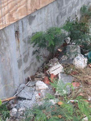 Of the many issues that are of serious concerns to residents of Jost Van Dyke and in particular Mr Rudolph E. George, as he is directly affected, is the execution of projects on the island. He alluded to the works being done to the cemetery wall which is in very close proximity to his business place. He alleged that the contract was awarded to someone who resides at Tortola and that individual has been making a mess of the project, leaving the area in an unsightly state. Photo: Team of Reporters