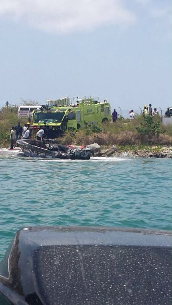 Officers of the Virgin Islands Fire and Rescue tending to the boat. Photo: Team of Reporters