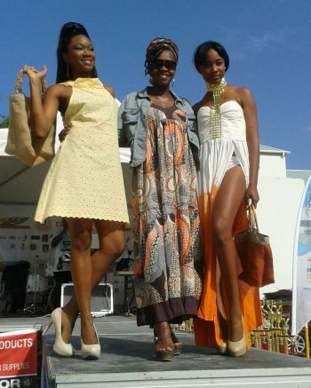 Turnbull-Smith flanked by two models wearing her designs. Photo: Provided