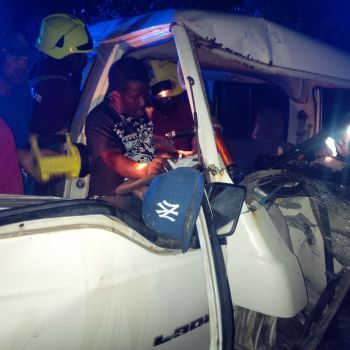The trapped driver of the crashed minibus. Photo:VINO