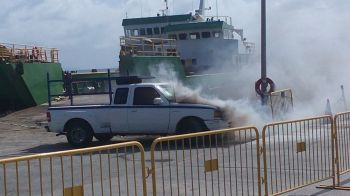 The vehicle on fire near the ferry dock at St Thomas Bay, Virgin Gorda today, June 12, 2015. It took the arrival of the Virgin Islands Fire and Rescue Services officers stationed on Virgin Gorda to put out the flames. Photo: Team of Reporters