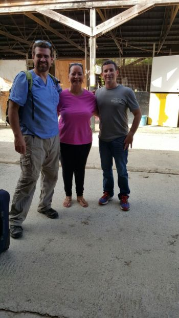Dr Manuel Himenes of Puerto Rico and Dr Joel Lugo of Florida, USA with Violet 'Letty' Hodge following the surgery. Photo: Provided