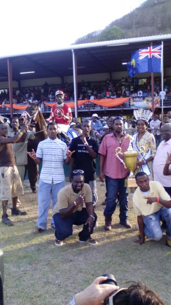 Winner's circle: Team St Moose victorious today. Holding the trophy is Miss BVI Adorya R. Baly while right is Governor of St Thomas Kenneth E. Mapp and left is St Moose owner James Bates. Photo: VINO