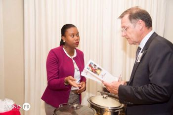 Our Young Professional explaining something to His Excellency Governor John S. Duncan OBE. Photo: Provided