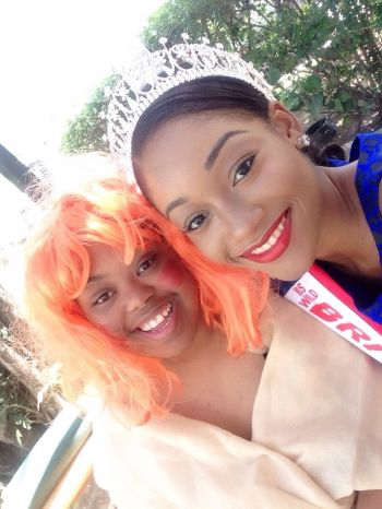 Miss BVI Sasha O. E. Wintz with one of the entertainers at the Eslyn Henley Richiez Learning Centre's Book in the Park on October 13, 2015. Photo: VINO