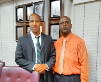 While many may not remember this is not the first time there has been a Youth Parliament set up in the Virgin Islands according to former Minister for Education and Culture Hon Andrew A. Fahie (R1) standing with Youth Parliamentarian Chezley L. D. Stoddard, [Youth Parliament] Representative for the First District. Photo: Team of Reporters