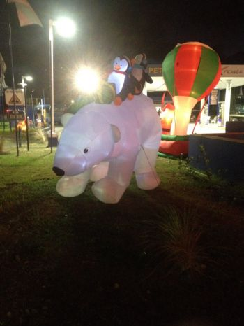 A huge polar bear, along with two penguins on his back, is included in the many attractive and colourful decorations at the Delta Petroleum service station in Pasea. Photo: Team of Reporters
