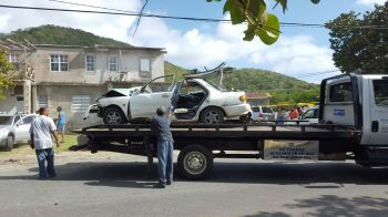The car, which bore the brunt of the damages in the accident, being removed from the scene. Photo: VINO