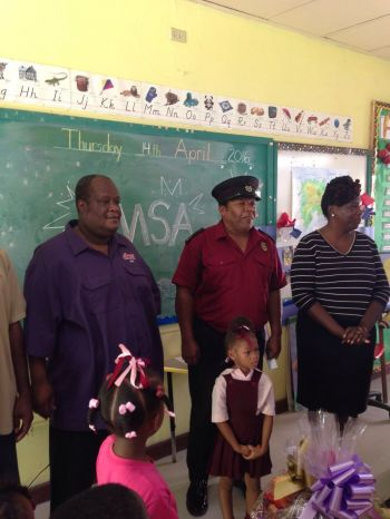 President of the BMSA Roy M. Thomas (left) speaking to students of the Enid Scatliffe Primary School on Thursday. Photo: Provided