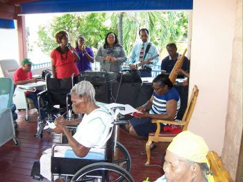 The BMSA presenting a wheelchair to the Adina Donovan Home in December 2015. Photo: Provided