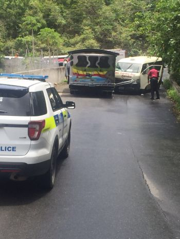 Police, fire and rescue officers, and EMTs were promptly on the scene of the accident on Cane Garden Bay Hill on July 6, 2016. Photo: Team of Reporters