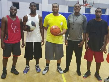 A few members of the 2016 Bayside Blazers squad that will be playing in the Hon Julian Fraser Save the Seed Basketball League. From left: McKenzie L. K. Baltimore, Tavon J. Phillip, Kyle L. Abraham, Bayside Blazers Head Coach Rhennie O. Phipps, and Shakeem E. Freeman. Photo: Provided