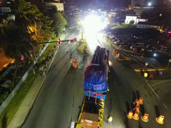 The movement of the generator was delayed for about an hour at the junction of James Walter Francis Carriageway and Station Road. Photo: Mahde Said