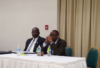Hon Julian Fraser RA (right) alongside outgoing Virgin Islands Party (VIP) President Carvin Malone at the VIP General Meeting on November 30, 2016. Photo: Team of Reporters
