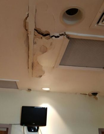 Collapsing ceiling directly above where staff works and the public comes to do business. Photo: Team of Reporters