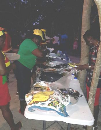 Digging in on the eateries at the beach lime on February 5, 2017 in observance of Grenada's 34th Independence Anniversary. Photo: Provided
