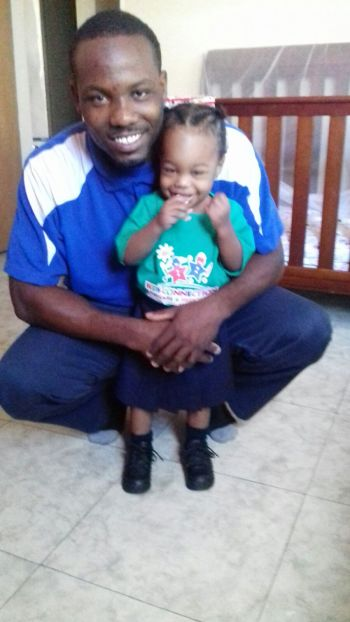 Mr Omar A. Jones with his child. Photo: Provided