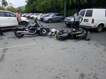 At least one of the police motor bikes was damaged in the incident in Road Town today, March 24, 2017. Photo: Team of Reporters