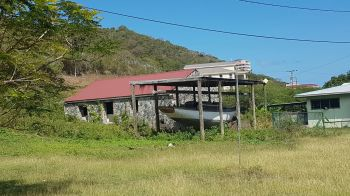The building on the left is to be demolished to facilitate the construction of the Virgin Islands Heritage Resource Centre at Paraquita Bay. Photo: VINO