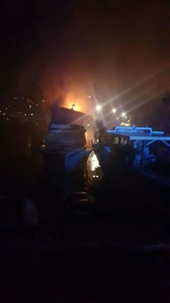 No one was injured but two boats were destroyed in a fire at a harbour in Baughers Bay, Tortola on April 4, 2017. Photo: Team of Reporters