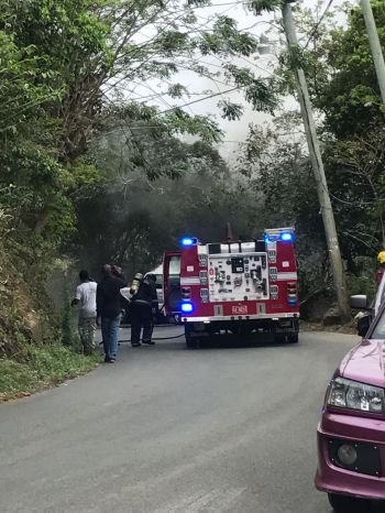 Fire fighters on the scene of the vehicle fire at Long Trench today, April 18, 2017. Photo: Team of Reporters
