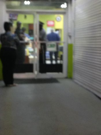A blurred image of police inside RiteWay following the armed robbery there this evening, April 19, 2017. Photo: Team of Reporters