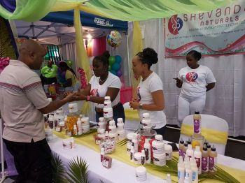 Patrons checking out 100% natural hair and skin care products made in the Virgin Islands at Shevandar Naturals. Photo: VINO