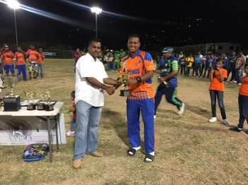 Vikings skipper Vaden Walker (right) receives his Man of the Match award from Flow BVI Representative Ravindra Maywahlall. Photo: Provided