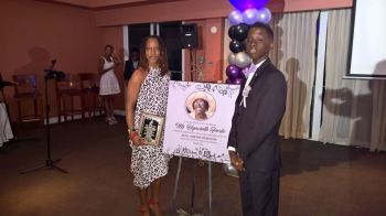The Jaleel Cameron Foundation presented Attorney at Law Mary-Lou Creque with a plaque and memory wall picture in honour of her mother Hyacinth Percival, who on her dying bed requested that all monies collected at her funeral service be given to Jaleel. Photo: VINO