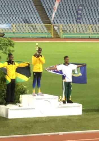 Proud podium moment: Akeela McMaster (right) during the presentation ceremony. Photo: Provided