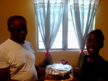 A care basket is given to Percy Benjamin (left) of Hannah's Estate by Unique Mc Lean. Photo: Provided