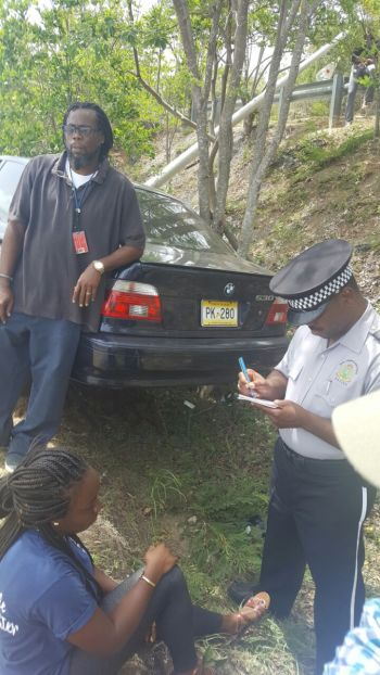 Police speaking to the drivers involved in the accident today, June 26, 2017 on Beef Island. Photo: VINO