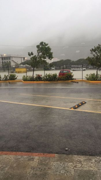 A flooded parking lot at Central Administration Complex today, July 13, 2017. Photo: Team of Reporters
