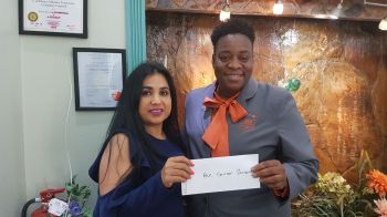 President of the BVI Cancer Society Ms Gloria A. Fahie, right, receives the monetary donation from Caribbean Insurers Ltd. Photo: VINO