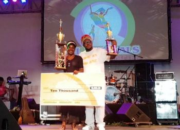 2017 Soca Monarch 'JJ' strikes a pose with Sista Joyce and his $10k prize. Photo: VINO