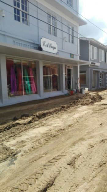 Many of the roads in Road Town are being graded but parking for vehicles remains an issue. Some stores that are still awaiting insurance assessments are not opened as yet to the public. Photo: VINO