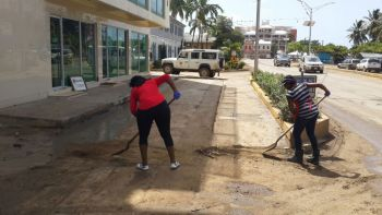 Volunteers from BVI Red Cross assisting with the cleaning-up of areas in Road Town. Photo: Provided