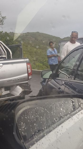 Persons on the scene of the accident inspect the damages. Photo: Team of Reporters